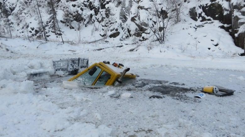 Snowcat breaks through ice, temporarily stalls N W T  remediation