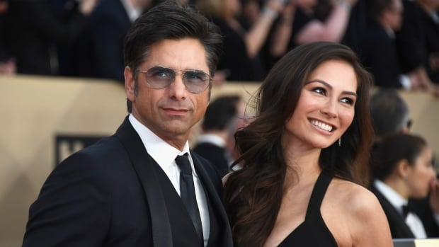 Caitlin McHugh seen with fiance John Stamos was robbed of thousands of dollars worth of jewelry from her hotel room Friday in Los Angeles Calif