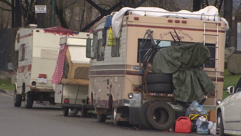 Several vans and RVs on Glen Drive in Vancouver are creating garbage and  safety problems, some local businesses say. (CBC)