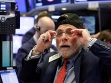 Trader Ronald Madarasz, right, works on the floor of the New York Stock Exchange, Feb. 6, 2018. The Dow Jones industrial average fell as much as 500 points in early trading, bringing the index down 10 per cent from the record high it reached on Jan. 26. The DJIA quickly recovered much of that loss.