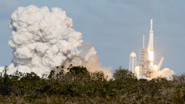 A SpaceX Falcon Heavy rocket lifts off from historic launch pad 39-A at the Kennedy Space Center in Cape Canaveral, Fla., on Tuesday afternoon.