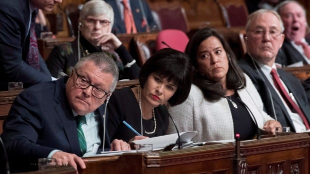 Minister of Public Safety and Emergency Preparedness Ralph Goodale, Minister of Health Ginette Petitpas Taylor, Minister of Justice and Attorney General of Canada Jody Wilson-Raybould and Bill Blair, M.P., parliamentary secretary, listen to a question on Bill C-45, the Cannabis Act, on Parliament Hill in Ottawa on Tuesday.