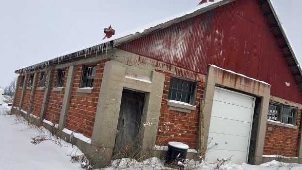 This is one of two barns built with red clay tile that are still standing on the property at 660 Sunningdale East. A third barn, the largest of the three, was demolished last year.