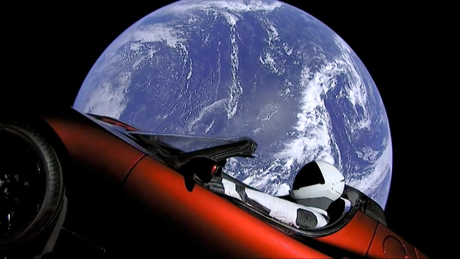 This image from video provided by SpaceX shows the company's spacesuit in Elon Musk's red Tesla sports car which was launched into space during the first test flight of the Falcon Heavy rocket on Tuesday, Feb. 6, 2018.