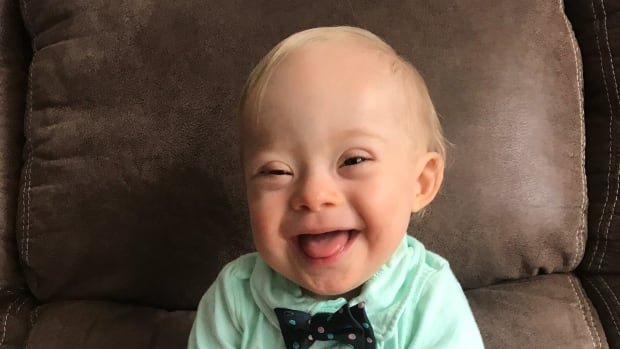 This September 2017 photo shows 14-month-old Lucas Warren of Dalton, Ga. Lucas' contagious smile won over executives at Gerber baby food who have made him their 'spokesbaby' this year.