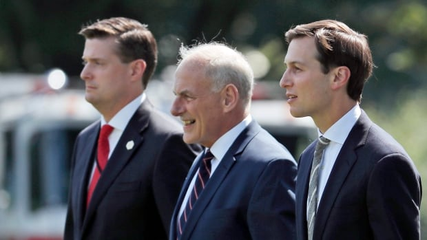 White House chief of staff John Kelly, centre, called Rob Porter, left, 'a man of true integrity and honour' before backtracking in a statement late Wednesday. Also seen in the August 2017 picture in Washington is White House senior adviser Jared Kushner, right.
