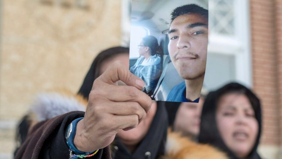 Debbie Baptiste, the mother of Colten Boushie, holds up a picture of her son during the trial in Battleford Sask., on Feb. 5, 2018.