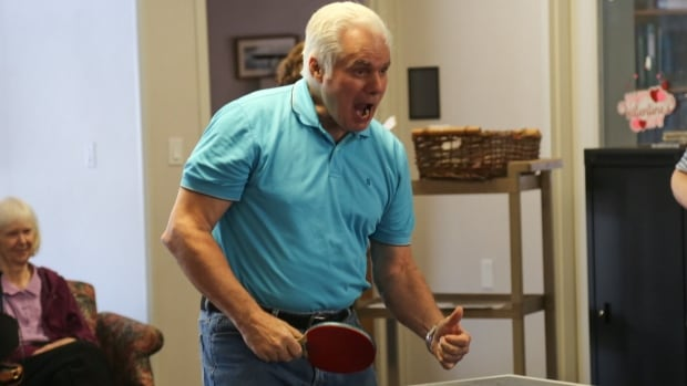 Resident John Piper, who has early Alzheimer's disease, gets into the game during Thursday ping pong at the Salvation Army Meighen Retirement Residence in midtown Toronto. Research suggests that ping pong might help early Alzheimer's patients ward off cognitive decline.