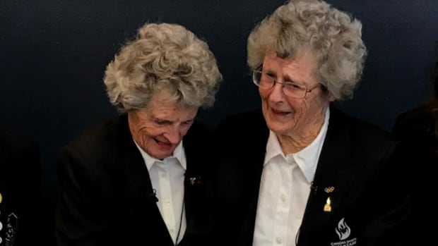 Rhoda Wurtele, left, stands with her twin sister Rhona Wurtele. It's been 70 years since they headed to St. Moritz, Switzerland on the RMS Queen Mary to compete in the 1948 Olympics.