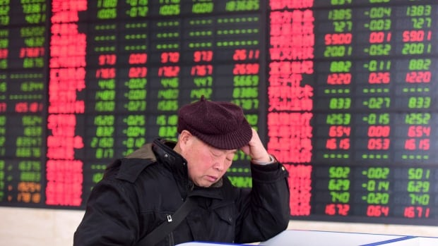 A Chinese investor monitors stock prices at a brokerage house in Fuyang in central China's Anhui province on Friday. Asian stocks plunged Friday after Dow Jones industrials on Wall Street plummeted more than 1,000 points on Thursday, deepening a week-long sell-off.