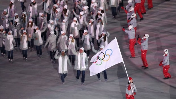 Members of the Olympic Athletes from Russia group enter the stadium under a Olympic flag during the opening ceremony of the PyeongChang 2018 Winter Games on Friday.