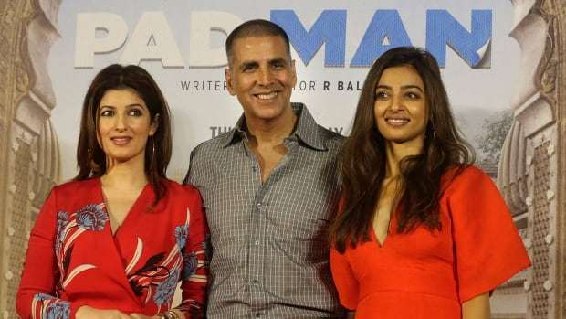 Bollywood actor Akshay Kumar, centre, with his wife Twinkle Khanna left, and Radhika Apte, right, pose for the media during launch of their film Pad Man. The film is inspired by a social activist who revolutionized the concept of menstrual hygiene in rural India.