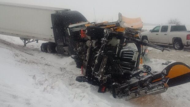 A transport truck driver is facing charges after hitting a snow plow in Chatham Kent.