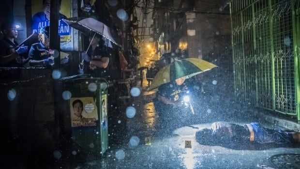 'It's more a war on class than a war on drugs': photojournalist documents unlawful killings in the Philippines | CBC Radio