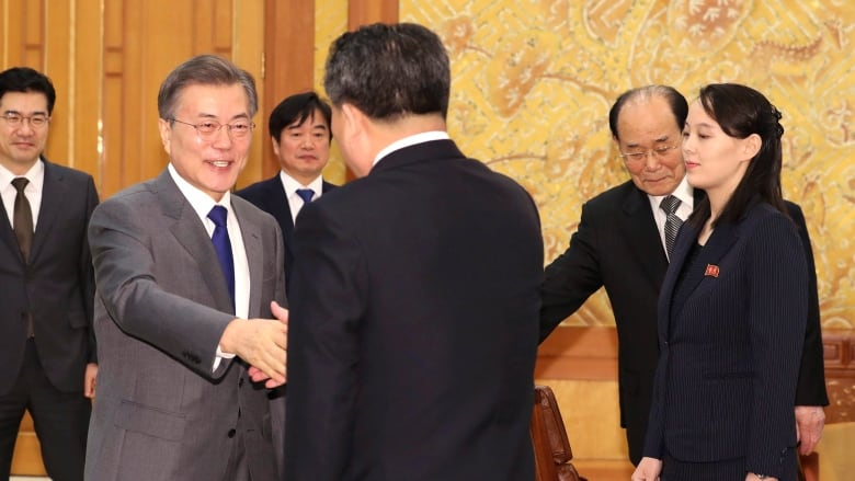 South korea says kim jong un has extended invitation for summit in south korean president moon jae in left shakes hands with ri son gwon chairman of the north koreas agency that deals with inter korean affairs stopboris Choice Image