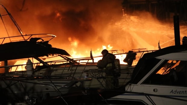 An investigation is underway after four boats were found on fire at the Reed Point Marina in Port Moody.