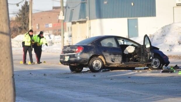 Investigators on scene of a two-vehicle collision on Dublin Avenue.