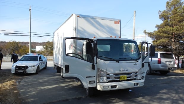 Bay Roberts RCMP say a 'high-risk takedown' involving this white cube truck was done Saturday afternoon. Two men have been arrested and charged with careless use of a firearm.
