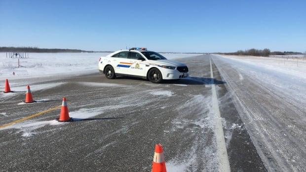 RCMP at the scene of a crash near Clandeboye, Man.