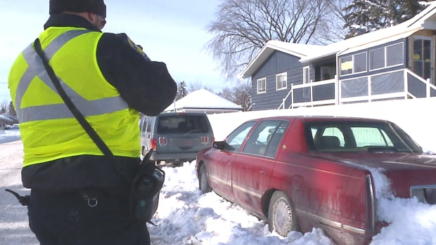 A vehicle on a snow route receives a ticket during the parking ban on Saturday. The city issued 1,920 tickets between 10 a.m. Saturday and noon Monday.