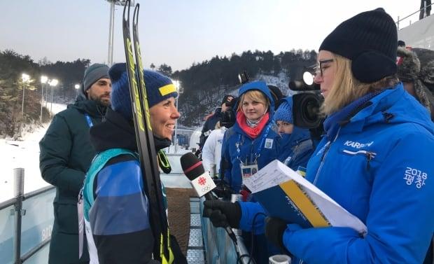 Karin Larsen interviewing skiathlon gold medalist Charlotte Kalla from Sweden