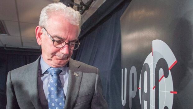 UPAC Commissioner Robert Lafrenière leaves the podium after speaking to the media in Montreal on Oct. 31, 2017. MNA Guy Ouellette was linked to a UPAC probe called Machurer, which looked into suspected illegal financing within the Liberal party under former leader Jean Charest.