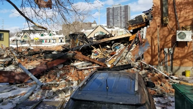 The explosion caused about one-third of the building to collapse, while the subsequent fire inflicted substantial damage to what remained.