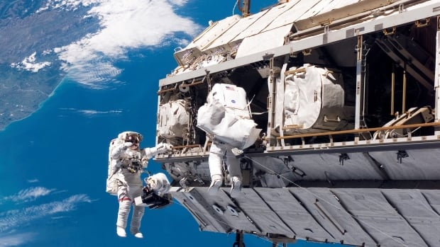 Astronaut Robert L. Curbeam Jr., left, and European Space Agency astronaut Christer Fuglesang participate in a space walk during construction of the International Space Station in this Dec. 2006 photo. Under President Donald Trump's 2019 proposed budget, U.S. government funding for the space station would cease by 2025.