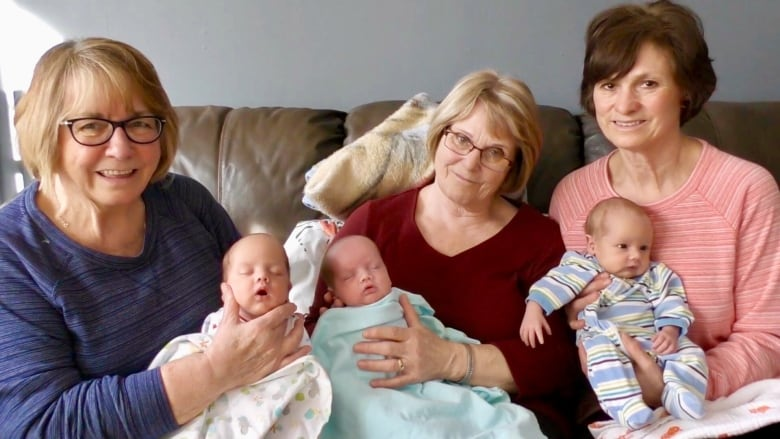 'It takes a village': Three P.E.I. grandmothers help exhausted mom care for triplets