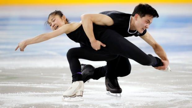 North Korea's figure skaters Ryom Tae-ok and Kim Ju-sik take part in a training session at the Gangneung Ice Arena in Gangneung, South Korea. The pair and the other 20 North Korean athletes have gotten an enthusiastic reception since arriving at the Pyeongchang Games.
