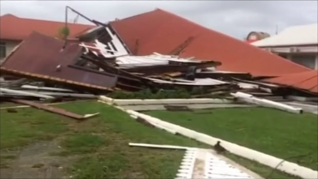 This image made from a video shows Parliament House damaged by Cyclone Gita in Tonga's capital on Tuesday. The country is cleaning up while people in the nearby Pacific nation of Fiji are preparing for the storm to hit them.