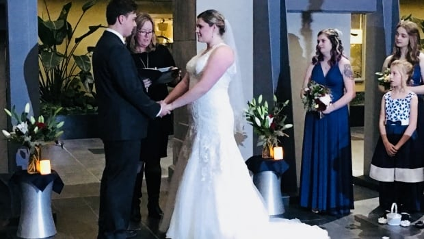 A downtown hospital atrium was transformed into a wedding venue thanks to the efforts of hospital staff.