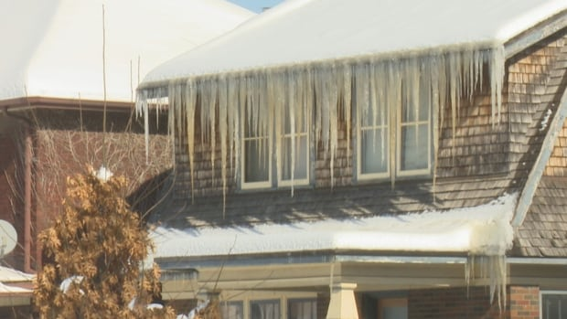 Large icicles caused by ice dams can lead to water damage in homes.
