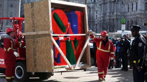 Workers move the famous 1976 Robert Indiana sculpture Love from a truck to a pedestal during its reinstallation in John F. Kennedy Plaza in Philadelphia on Tuesday.
