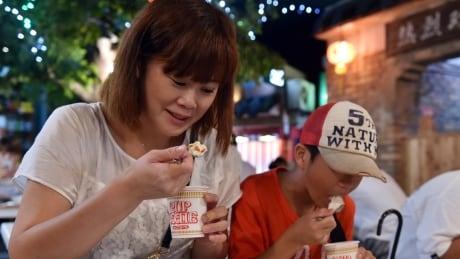 Woman eats in Japan