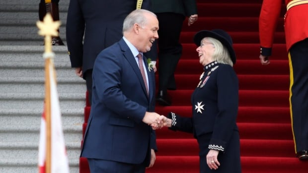 Premier John Horgan and Lt.-Gov. Judith Guichon meet on the steps of legislature before the speech from the throne in the legislative assembly in Victoria, B.C., on Tuesday, Feb. 13, 2018.