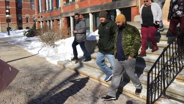 James Turpin, wearing a gold tuque and camouflage jacket, leaves the Fredericton courthouse on Tuesday. He is appealing his second-degree murder conviction.