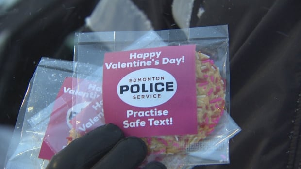 Edmonton police officers handed out cookies to drivers stopped at Whyte Ave. and Gateway Blvd. during the morning commute Wednesday reminding drivers not to text and drive.