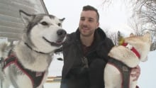Colin Langlois with his huskies, Obi and Leia.