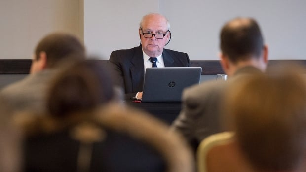 John Walter Thompson chairs a Nova Scotia human rights board of inquiry, dealing with persons with disabilities and their attempts to move out of institutions and into small homes, in Halifax on Monday, Feb. 5, 2018.