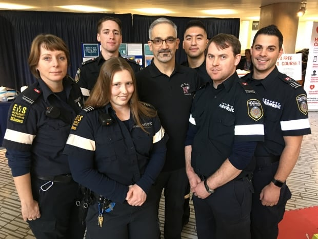 John Turco poses with paramedics that helped save his life