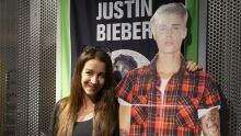 Pattie Mellette posing with Justin Bieber cutout