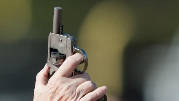 Delta student in custody after carrying starter pistol to school