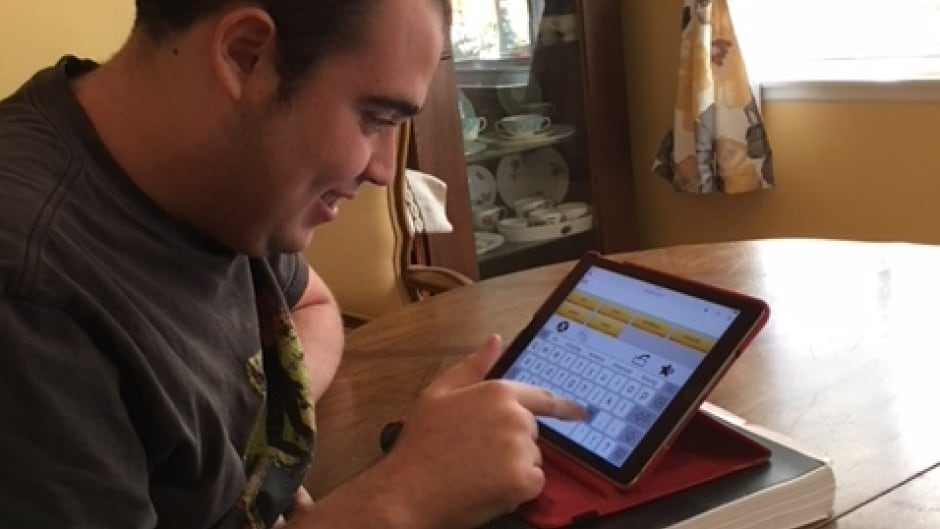 Ido Kedar uses his iPad to communicate.
