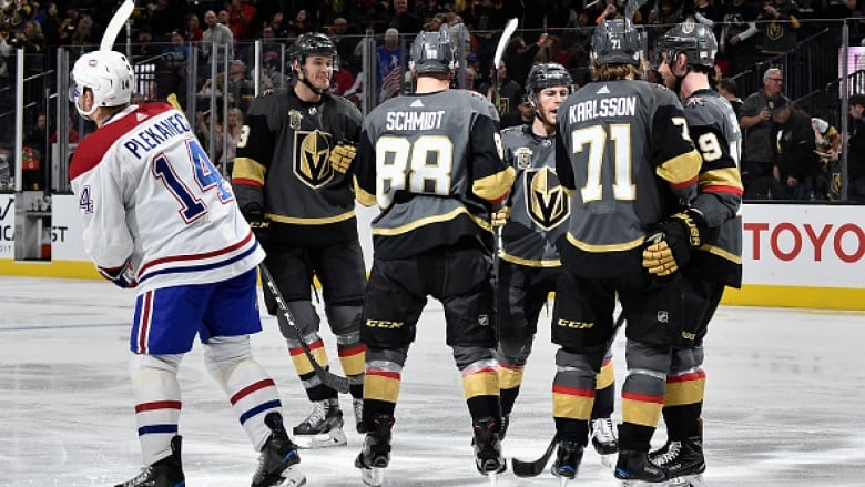 24fe7f554 Montreal Canadiens centre Tomas Plekanec (14) reacts as Vegas Golden Knights  defenceman Nate Schmidt (88) celebrates his goal with teammates during  Vegas' ...