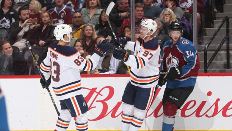 Matt Benning (83) and Connor McDavid (97) of the Edmonton Oilers celebrate  a goal during Edmonton s 4-2 win over the Colorado Avalanche on Sunday. 80adc61c1