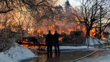 Don Agar and father watch blaze at family homestead