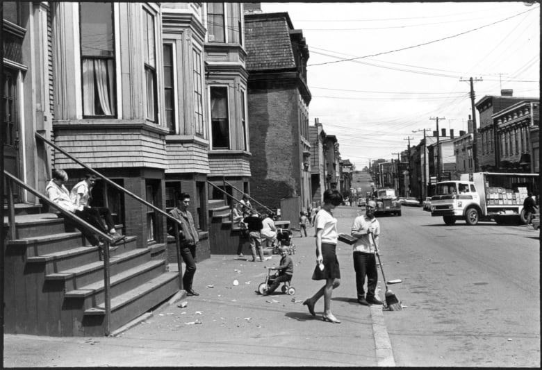 Children Playing As A Man Sweeps The Street And Deliveries Are Unloaded On St James Street Saint John To Maceachern Was Always A City Of Contrasts He