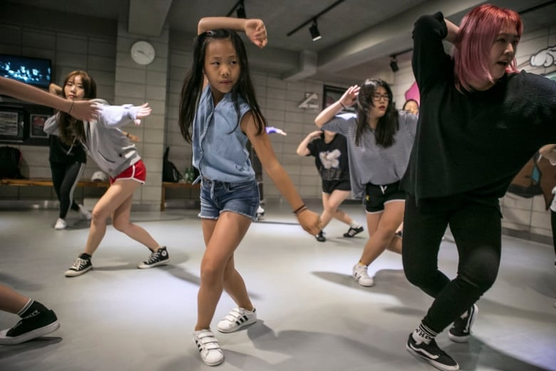 The punishing pressures behind K-pop perfection | CBC News