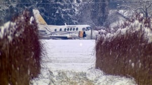2 taken to hospital after aircraft skids off runway at Abbotsford airport in snowy weather